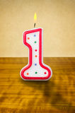 Birthday candle number 1. Burning birthday candle number 1 Stock Images