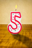 Birthday candle number 5. Burning birthday candle number 5 Royalty Free Stock Photos