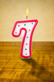 Birthday candle number 7. Burning birthday candle number 7 Stock Photography