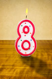 Birthday candle number 8. Burning birthday candle number 8 Royalty Free Stock Photos