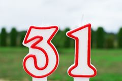 Birthday candle in shape of number 31 royalty free stock photos