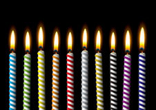Birthday candle stripe party. Collection of stripe candles with spiral design and bright flame Stock Photo
