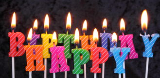 Birthday candles. Colored birthday candles that spell happy birthday Royalty Free Stock Image
