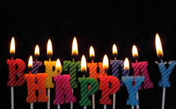 Birthday candles. Colored birthday candles that spell happy birthday Royalty Free Stock Photo