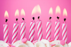 Birthday candles. Eight birthday candles against a pink background Royalty Free Stock Photography