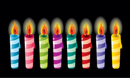 Birthday candles. Set of multicolor birthday candles on black Stock Photos