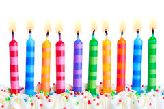 Birthday candles. Ten birthday cake candles against a white background Royalty Free Stock Image