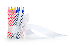 Birthday Candles. With silk white ribbon against a white background Stock Images