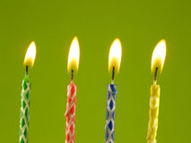 Birthday candles. Row on birthday candles against green background Stock Images