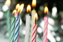 Birthday candles. Lit birthday candles Royalty Free Stock Photography