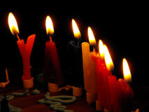 Birthday Candles. Letter-shaped birthday candles on a birthday cake in the dark Royalty Free Stock Photo