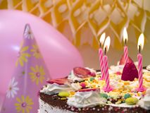 Birthday candles. Birthday cake with candles, close up, pink balloon at background royalty free stock images