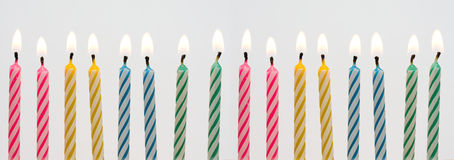 Birthday candles. Colorful birthday candles arranged in row as banner - sweet sixteen