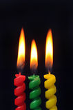 Birthday Candles. Glow on a black background Stock Photo