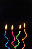 Birthday Candles. Glowing on Blackbackground Stock Photography