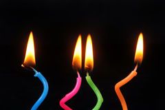 Birthday Candles. Glowing on Black Background Stock Image