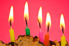 Birthday candles against red background Royalty Free Stock Image