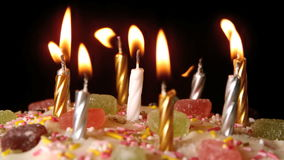 Birthday candles being blown out on a delicious cake close up stock footage