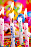 Candles. Birthday candles burning and with wax dripping. Festive colorful background Royalty Free Stock Photography