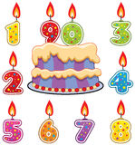 Birthday candles and cake Royalty Free Stock Image