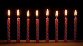 Birthday candles on cake. Closeup of many small birthday candles in the dark stock footage