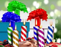 Birthday candles on a cake. And gift boxes Stock Photos
