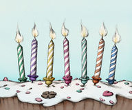 Birthday candles on a cake. Illustration of birthday candles on cake Royalty Free Stock Image