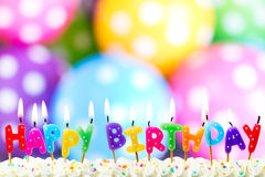 Birthday candles. Colorful happy birthday candles on a cake Stock Photo