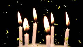 Birthday candles with confetti falling. Animation of a close up of birthday candles being blown off with golden confetti falling on a black background vector illustration