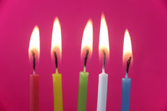 Birthday Candles. Five small birthday candles against pink background Royalty Free Stock Photos