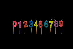 Birthday candles numbers. Set of colorful birthday candles on the black background Numbers 0-9 Stock Photography