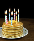 Birthday candles on pancake stack Royalty Free Stock Photos