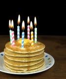 Birthday candles on pancake stack Royalty Free Stock Photos