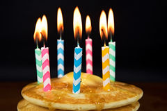 Birthday candles on pancakes royalty free stock images
