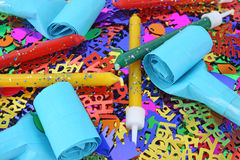 Birthday candles and party blowers with confetti Royalty Free Stock Photo