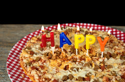 Birthday candles on pizza Stock Images