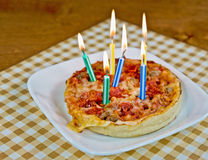 Birthday candles on pizza Stock Image