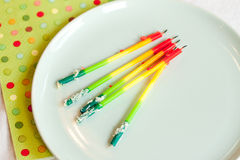 Birthday candles on plate Royalty Free Stock Image