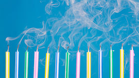 Birthday candles in a row with smoke Royalty Free Stock Photos