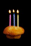 Birthday Candle. S on the top of cupcake, black background royalty free stock photo