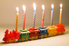 Toy Train and Birthday Candles Stock Photo