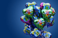 Birthday card. With balloons on blue background Stock Photos