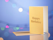 Birthday card. With a gift by the side Stock Images