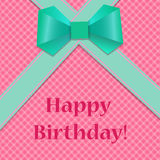 Birthday card with green ribbons and bow on checkered pink backg Royalty Free Stock Image