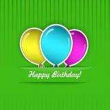 Birthday Card. Green Birthday Card with three multicolored balloons, cut from paper Stock Images
