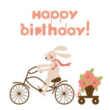 Birthday card with a hare on a bicycle and flowers. Stock Image