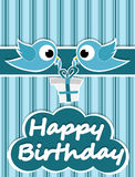 Birthday card illustrated birds and birthday gifts Stock Images