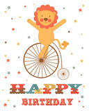 Birthday card with lion on wheel Stock Images