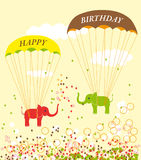 Birthday card with Parachuting Elephants. And bubbles on yellow background Royalty Free Stock Photography