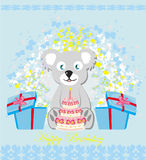 Birthday card, sweet teddy bear holding a birthday cake Stock Photo